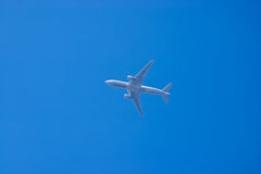 Airplane in a blue sky Royalty Free Stock Photo