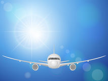 Airplane on blue sky Royalty Free Stock Photo
