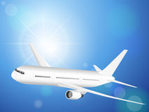 Airplane on blue sky Stock Photos