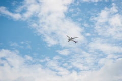 Airplane in the blue sky Royalty Free Stock Photo