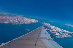 Airplane through the blue sky. Royalty Free Stock Photo