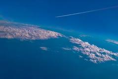 Airplane through the blue sky. Stock Image