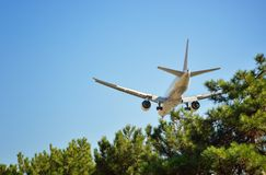 Airplane in blue sky stock photos