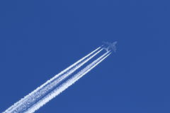 Airplane on the blue sky background Stock Images