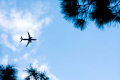 Airplane in Blue Sky Royalty Free Stock Photography