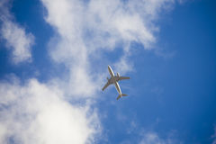 Airplane in the blue sky Stock Image