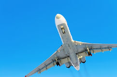 Airplane blue sky clouds flight airport.  Royalty Free Stock Photo