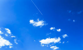 Airplane in blue sky. Airplane is flying  in blue sky Stock Images