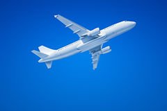 Airplane in the blue sky Stock Images