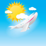 Airplane in blue sky with sun and clouds. Stock Image