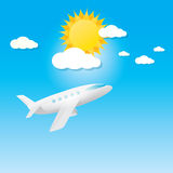 Airplane in blue sky with sun and clouds. Royalty Free Stock Images