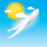Airplane in blue sky with sun and clouds. Royalty Free Stock Photos