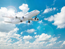 Airplane in the blue sky. Royalty Free Stock Image