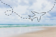 Airplane and blurred beach background Stock Images