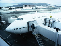 Airplane Boeing 747 at terminal Stock Image