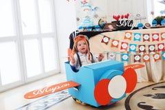 Airplane box baby boy play cute aviator pilot Royalty Free Stock Photos