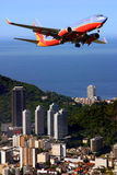 Airplane in Brazil. Airplane over Ipanema beach in Brazil Stock Photo