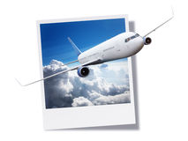 Airplane breaking free from an instant print photo or postcard. Passanger airplane flying above clouds breaking free from an instant print photo or postcard Royalty Free Stock Image