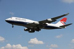 A airplane of British Airways. Flying in the sky, boeing 747 stock image