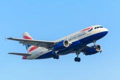 Airplane  British Airways G-DBCJ Airbus A319-100 is landing at Schiphol airport Stock Photos