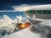 Airplane with burning engine Stock Image