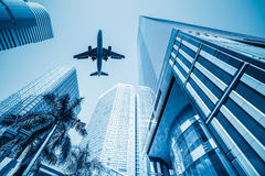 Airplane and business buildings Stock Photos