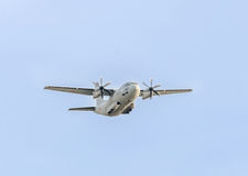 Airplane C-27-J Spartan flying in the blue sky, aircraft, isolated, close up Royalty Free Stock Image