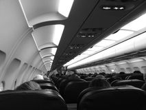 Airplane cabin. Passengers seated in an airplane cabin Royalty Free Stock Photos