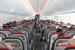 Airplane cabin aisle with rear view and seatsstock, photo, photograph, image, picture. Airplane cabin aisle with rear view and seats stock, photo, photograph stock photos
