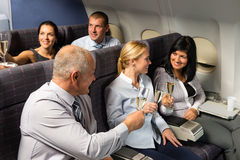 Airplane cabin businesspeople toasting champagne Royalty Free Stock Images