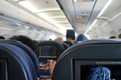 Airplane cabin interior passengers Stock Photo