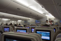 Airplane cabin interior with passengers Stock Images