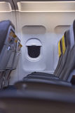 Airplane cabin interior  view. Empty seats Royalty Free Stock Photos