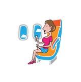 Airplane cabin passenger woman smart phone Royalty Free Stock Image