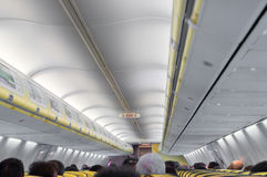 Airplane cabin with passengers Royalty Free Stock Images