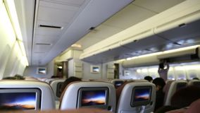 Airplane cabin with passengers stock video footage