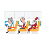 Airplane cabin passengers and smart phones and Santa Stock Images