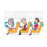 Airplane cabin passengers and smart phones Stock Images