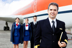 Airplane captain with crew Royalty Free Stock Image