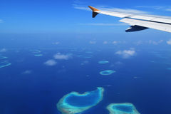 Airplane carrying holiday makers landing in maldives Stock Photos