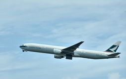 Airplane of Cathay Pacific Airlines is departuring Stock Images