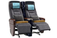 Airplane chairs pillows. Airplane chairs textiles with gray pillows. 3D graphic Royalty Free Stock Photography
