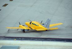 Airplane charter, yellow taxi. Taxi airplane available for island charter stock images