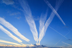 Airplane chemtrails in sky Stock Image
