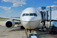 Airplane at Chicago airport. Airplane ground maintenance, Chicago International Airport, shown as working and operations in airport, and industrial of Royalty Free Stock Image