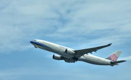 Airplane of China Airlines is departuring Stock Photos