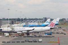 Airplane of China Airlines at the gate, Amsterdam Schiphol airport, Netherlands  Stock Photos