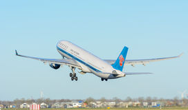 Airplane China Southern Airlines B-5965 Airbus A330-300 is taking off at Schiphol airport. Royalty Free Stock Photography