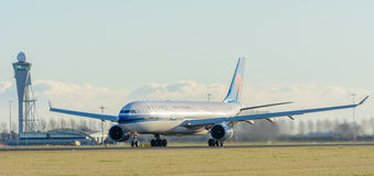 Airplane China Southern Airlines B-5965 Airbus A330-300 is taking off at Schiphol airport. Stock Images
