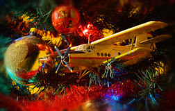 Airplane and Christmas decorations Royalty Free Stock Photography